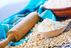 Oat flour. In bowl and on a table Stock Image