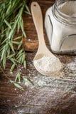 Oat flour, grain oats on wooden background. Oat flour, grain oats, oat bread on wooden background with home lyanm textiles. selective Focus Stock Photography