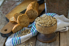 Oat grain bread with oats and linen. Oat grain bread with oats on a wooden background with linen textiles. selective Focus Royalty Free Stock Photos