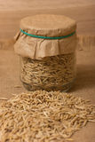 Oat grains in a jar Stock Photos