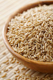 Oat grains. Wooden bowl full of oat grains Stock Photography