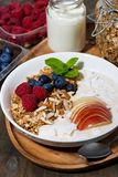 oat granola with apples and berries on wooden background stock image
