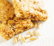 Oat granola bars on wooden table Royalty Free Stock Images