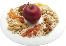 Oat groats on a plate with nuts,apple Royalty Free Stock Photo