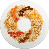 Oat groats on a plate with nuts Royalty Free Stock Images