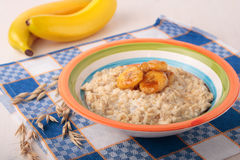 Oat meal with caramelized banana Royalty Free Stock Photography