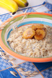 Oat meal with caramelized banana on plate Stock Photos