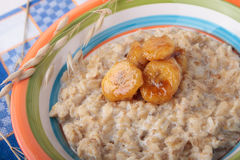 Oat meal with caramelized banana slices Stock Photo