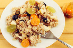 Oat muesli with berries, healthy breakfast, toned. Effect Royalty Free Stock Photos