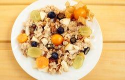 Oat muesli with berries, healthy breakfast. On wooden desk Stock Image