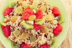 Oat muesli with kiwi and grapefruit. Tasty and healthy breakfast Stock Images