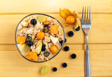 Oat muesli with physalis, blueberry and grape. Healthy breakfast Stock Photos