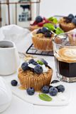 Oat muffin with coffee for breakfast Stock Images