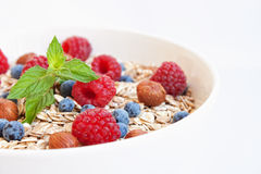 Oat nuts breakfast. Oat nuts with fresh blueberries and raspberries and hazelnuts Stock Photos