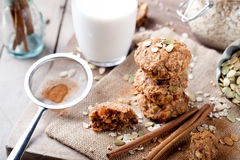 Oat and peanut butter cookies with pumpkin seeds,cinnamon,milk. Stock Photo