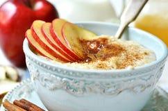 Oat porridge with apple,honey and cinnamon. Stock Photos