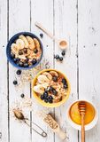 Oat porridge with banana and blueberries, healthy morning nutrit Royalty Free Stock Photography