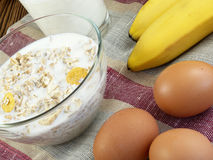 Oat porridge  with banana and milk Royalty Free Stock Photography