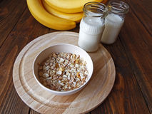 Oat porridge with bananas and yogurt. On a wooden table Royalty Free Stock Photography