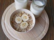 Oat porridge with bananas and yogurt. On a wooden table Stock Image
