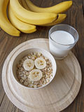 Oat porridge with bananas and yogurt. On a wooden table Royalty Free Stock Image