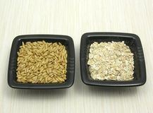 Oat and porridge on beige placemat Stock Photos