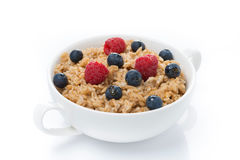 Oat porridge with berries in a bowl, isolated Royalty Free Stock Photography