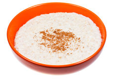 Oat porridge with cinnamon in orange bow Royalty Free Stock Image