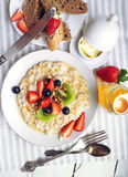 Oat porridge with fresh berries and honey Stock Photography
