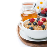 oat porridge with fresh berries and honey, black tea, isolated Stock Images