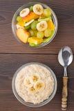 Oat porridge and fruits Royalty Free Stock Image