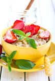 Oat porridge with honey Stock Photo