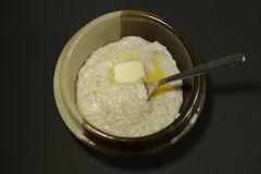 Oat porridge milk butter dark background high angle Stock Images