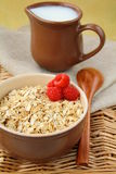 Oat porridge with milk and ripe raspberries. Healthy breakfast stock images