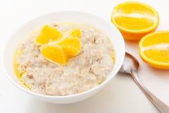 Oat porridge with oranges Royalty Free Stock Photo