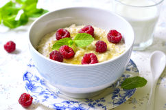 Oat porridge with raspberry and honey. Royalty Free Stock Images