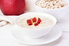 Oat porridge with red apple slices Royalty Free Stock Image