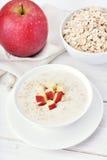 Oat porridge with red apple slices Stock Photo