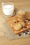 Oat and raisin cookies with milk Stock Images