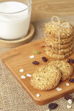 Oat and raisin cookies with milk Royalty Free Stock Images