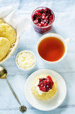 Oat scones with cream cheese and caramelised plums Royalty Free Stock Photo