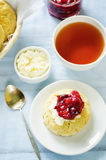 Oat scones with cream cheese and caramelised plums Royalty Free Stock Photos