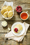Oat scones with cream cheese and caramelised plums Stock Photography