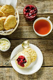Oat scones with cream cheese and caramelised plums Stock Image