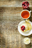 Oat scones with cream cheese and caramelised plums Stock Photos