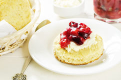 Oat scones with cream cheese and caramelised plums Royalty Free Stock Image