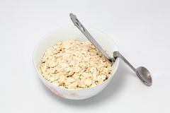Oat and spoon Royalty Free Stock Images