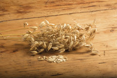 Oat on table. Oats, oats grain and flakes on a wooden table stock image