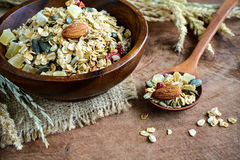 Oat and whole wheat grains flake in wooden bowl Royalty Free Stock Photo