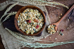 Oat and whole wheat grains flake in wooden bowl Royalty Free Stock Photography